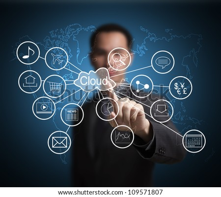 business man pointing at cloud computing and connected world wide application network