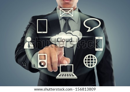 Business man pointing at cloud computing on virtual background - stock photo