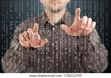 Business man pointing at code list on digital touchscreen - stock photo