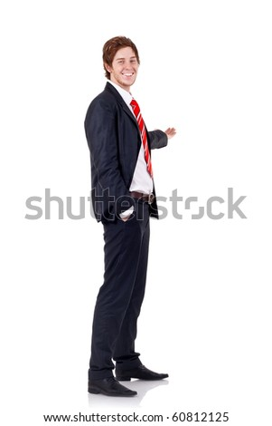 business man pointing at something as if he was presenting - isolated over a white background - stock photo