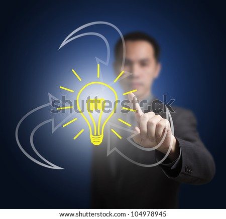 business man pointing at synergy idea symbol - stock photo