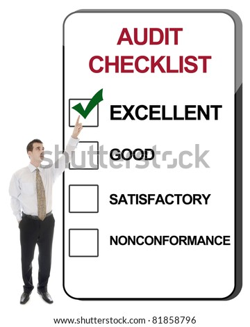 Business man pointing Audit Checklist - stock photo