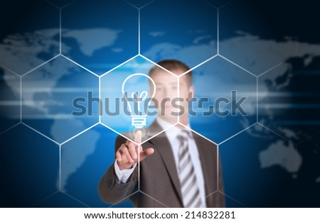Business man pointing her finger at light bulb icon
