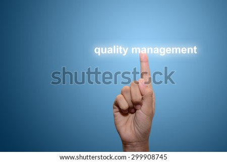Business man pointing quality management - stock photo