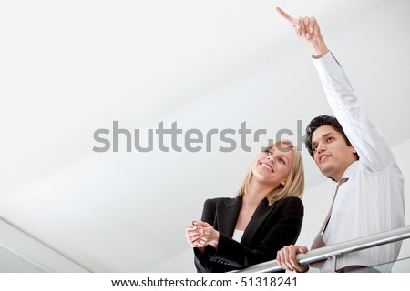 Business man pointing something to his partner in an office - stock photo