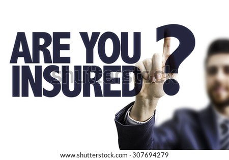 Business man pointing the text: Are You Insured? - stock photo