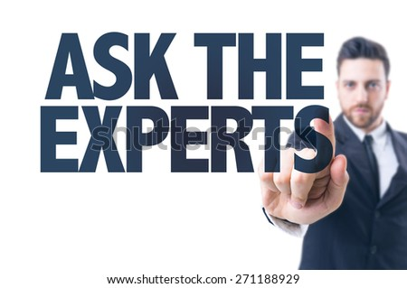 Business man pointing the text: Ask the Experts - stock photo