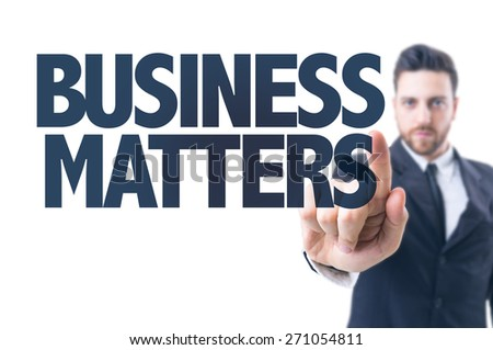Business man pointing the text: Business Matters - stock photo
