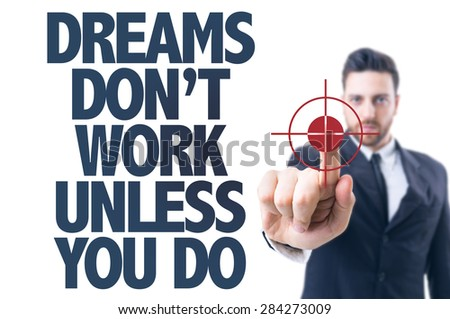 Business man pointing the text: Dreams Don't Work Unless You Do - stock photo