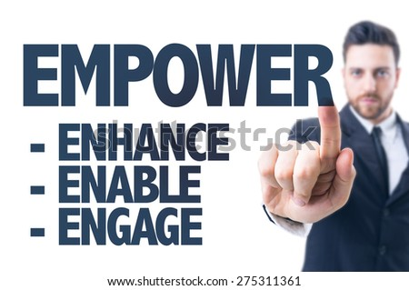 Business man pointing the text: Empower - stock photo