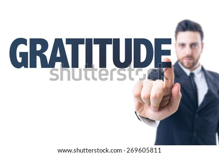 Business man pointing the text: Gratitude - stock photo