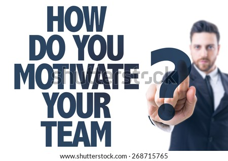 Business man pointing the text: How Do You Motivate Your Team? - stock photo