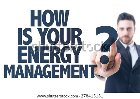 Business man pointing the text: How is Your Energy Management? - stock photo