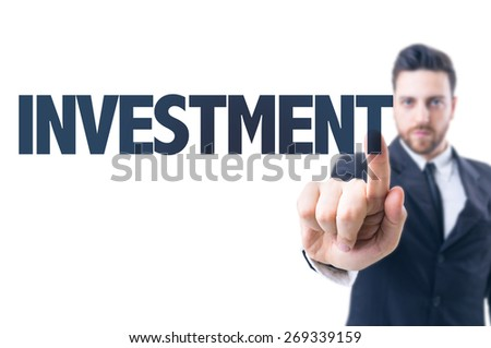 Business man pointing the text: Investment - stock photo
