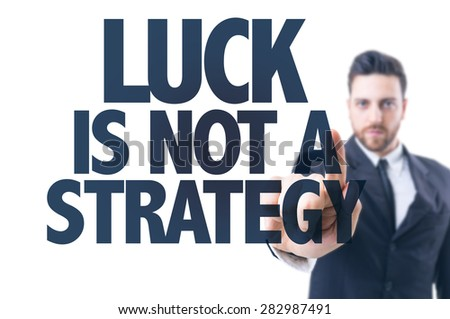 Business man pointing the text: Luck is Not a Strategy - stock photo