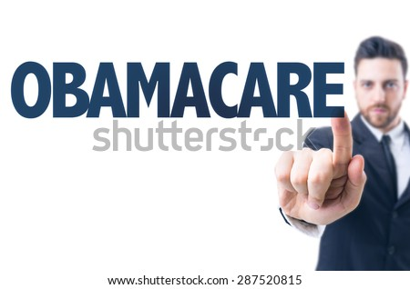 Business man pointing the text: Obamacare - stock photo