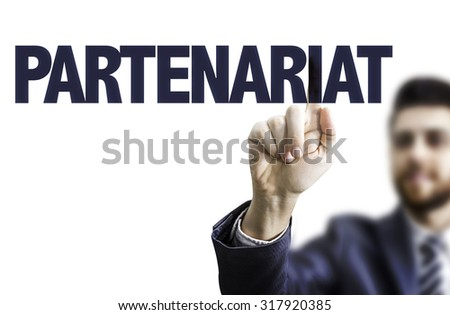 Business man pointing the text: Partnership (in French) - stock photo