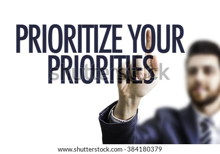 Business man pointing the text: Prioritize Your Priorities - stock photo