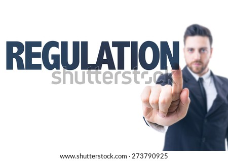 Business man pointing the text: Regulation - stock photo