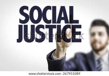 Business man pointing the text: Social Justice - stock photo