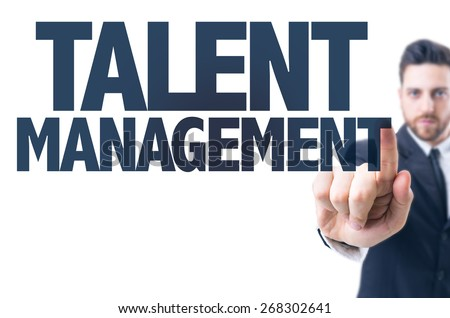 Business man pointing the text: Talent Management  - stock photo