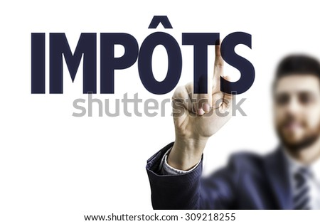 Business man pointing the text: Taxes (in French) - stock photo