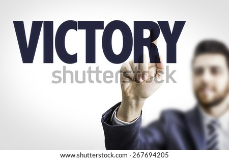 Business man pointing the text: Victory - stock photo