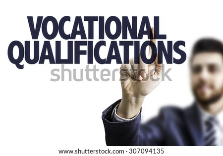 Business man pointing the text: Vocational Qualifications - stock photo