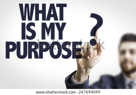 Business man pointing the text: What Is My Purpose? - stock photo
