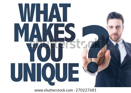 Business man pointing the text: What Makes You Unique? - stock photo