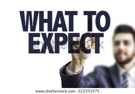 Business man pointing the text: What To Expect - stock photo