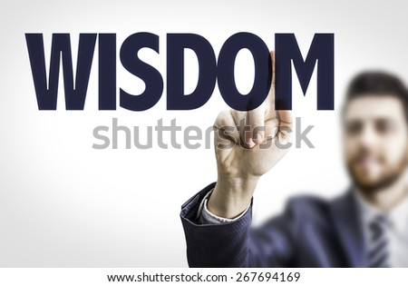 Business man pointing the text: Wisdom - stock photo