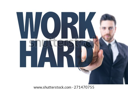 Business man pointing the text: Work Hard - stock photo