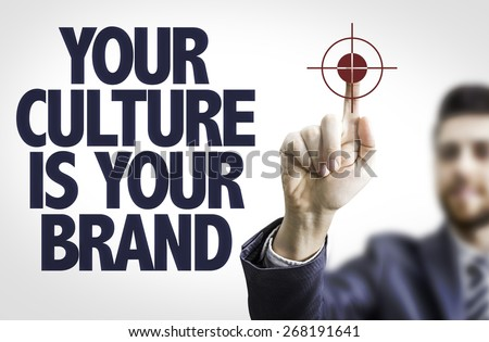 Business man pointing the text: Your Culture is Your Brand - stock photo