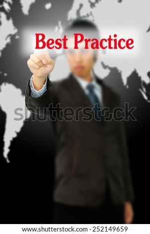 Business man pointing to black board with text: Best Practice  - stock photo
