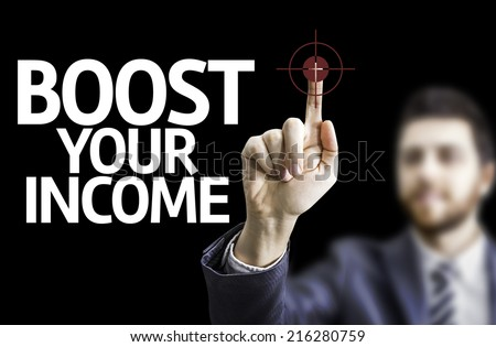 Business man pointing to black board with text: Boost Your Income  - stock photo