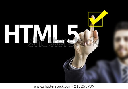 Business man pointing to black board with text: HTML 5 - stock photo