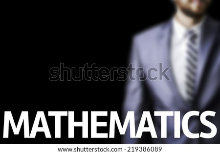 Business man pointing to black board with text: Mathematics - stock photo