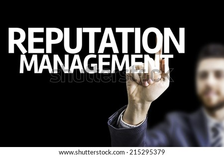 Business man pointing to black board with text: Reputation Management  - stock photo