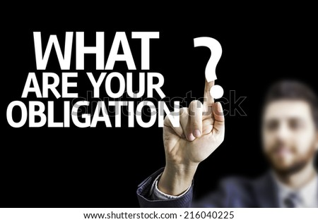 Business man pointing to black board with text: What are Your Obligation?  - stock photo