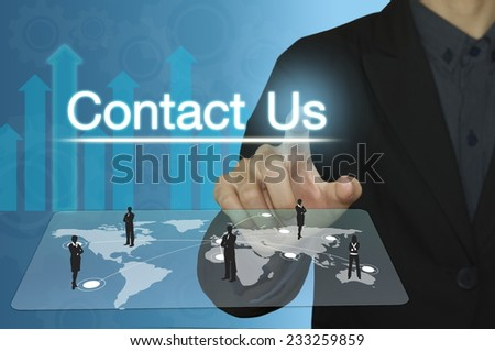 Business man pointing to Contact us on computer screen. - stock photo