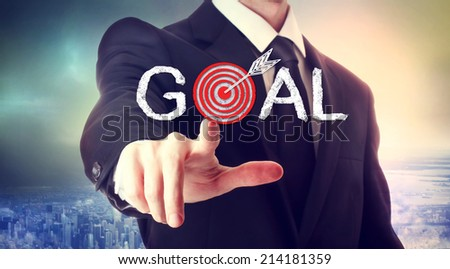 Business man pointing to the target, reaching the goal - stock photo