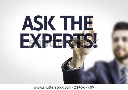 Business man pointing to transparent board with text: Ask the Experts!  - stock photo