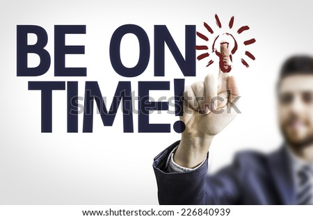 Business man pointing to transparent board with text: Be on Time - stock photo