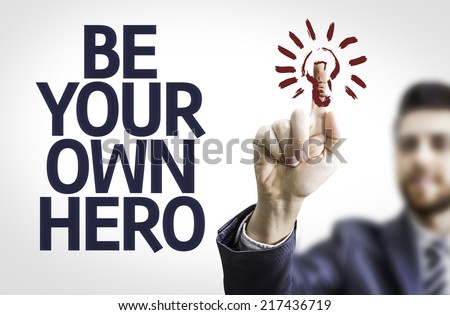 Business man pointing to transparent board with text: Be your Own Hero - stock photo