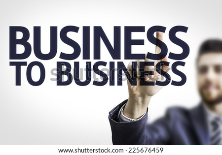 Business man pointing to transparent board with text: Business to Business - stock photo