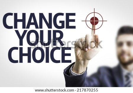 Business man pointing to transparent board with text: Change Your Choice - stock photo