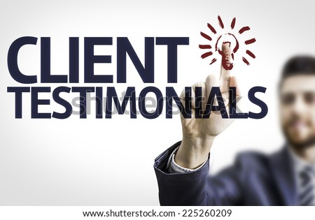 Business man pointing to transparent board with text: Client Testimonials - stock photo