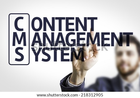 Business man pointing to transparent board with text: Content Management System - stock photo