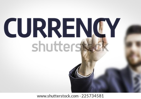 Business man pointing to transparent board with text: Currency - stock photo